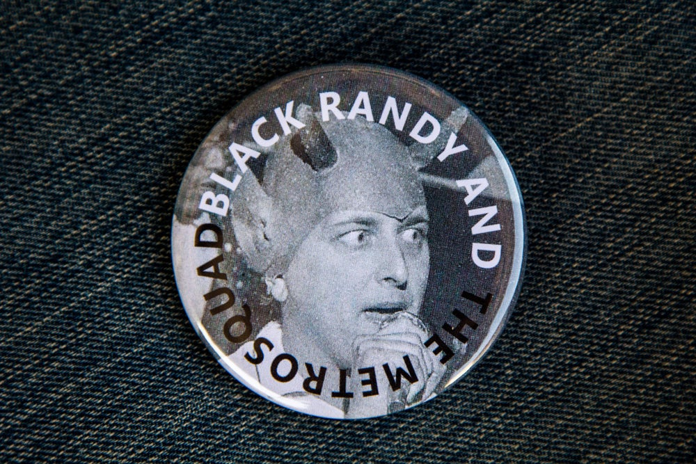 "Image of Black Randy & The Metrosquad 2 1/2"" Pin"