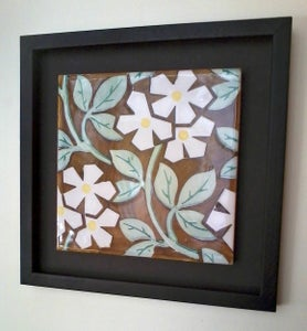 Image of White flowers with a yellow heart ceramic framed tile.