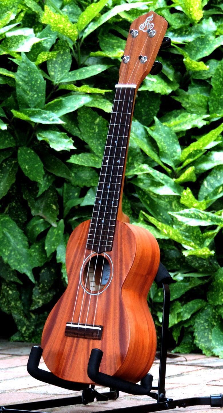 Image of **PRE-OWNED** LoPrinzi Model A Solid Flame Mahogany Soprano Ukulele