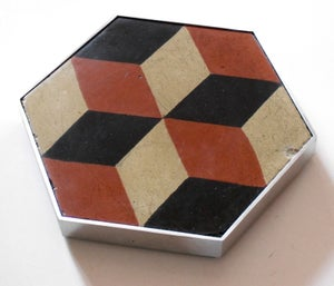 Image of Escher rust hexagonal trivet