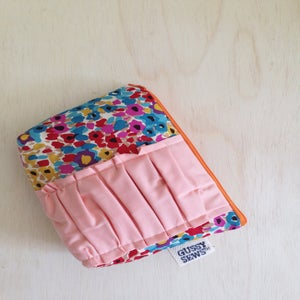 Image of watercolors with peach ruffle, large zip pouch