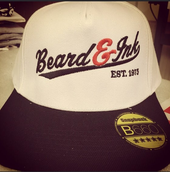 Image of Beard and Ink Script Logo Unisex White and Black Snapback Cap