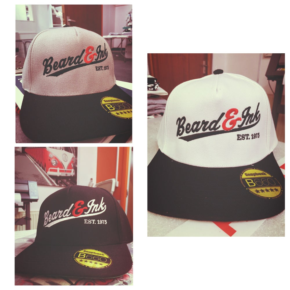 Image of Beard and Ink Script Logo Unisex White and Black Snapback Cap