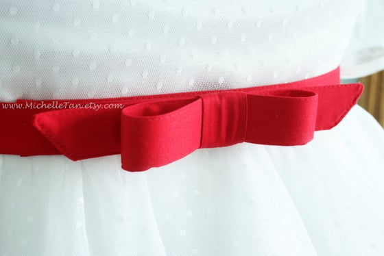 Image of red bow belt