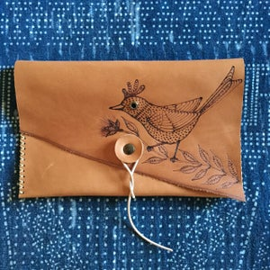 Image of Bird in a branch Clutch
