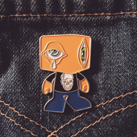 "Image of ""Man-E-Eyes"" pin"