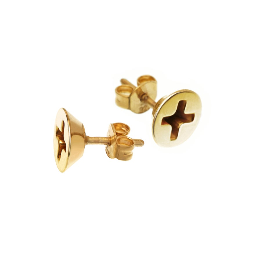 YOUR EAR PIERCED BY A SCREW  Cross-head screw studs, 8mm diameter 18k goldplated  A statement, a technical touch but still delicate  As in all our pieces we work only with high quality, handmade and detailed craftmanship.  Possible to buy a single piece!