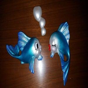 Image of Vintage reproduction Freeman McFarlin fish set with heart bubble