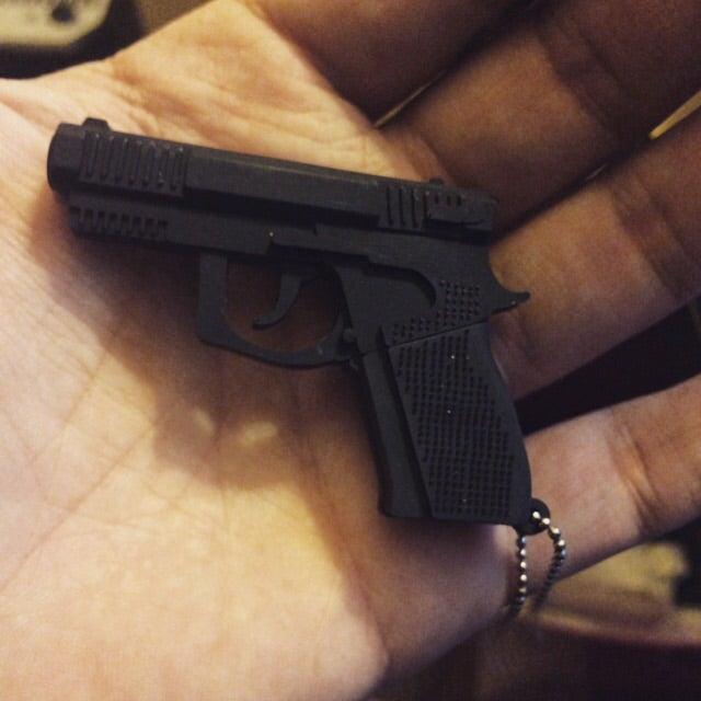 Image of Digital goodness!  8gb gun USB keychain w/14 digital issues!