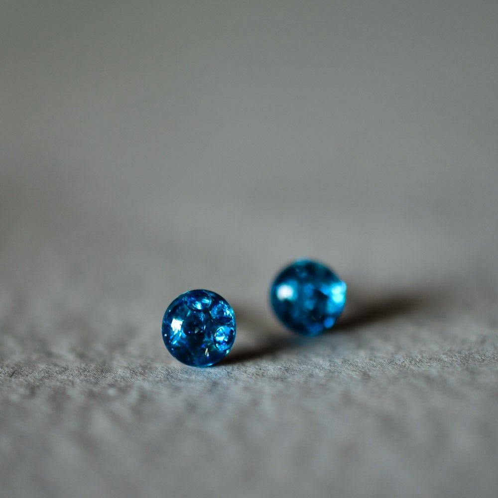 Image of Tiny cubic zirconia stud earrings in resin, sterling silver