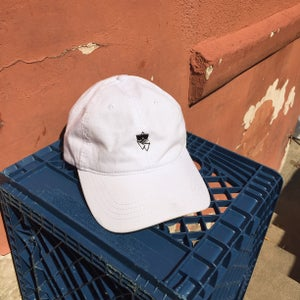 "Image of White Golf ""R"" Cap"