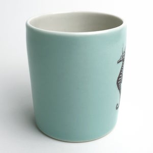 Image of 14oz tumbler in aqua with seahorse