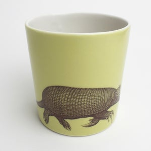 Image of 14oz tumbler with armadillo, mustard