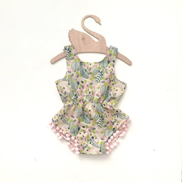 Image of 'natural feather' pom playsuit