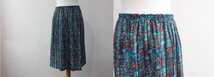 Image of 80's glass printed midi skirt UK10