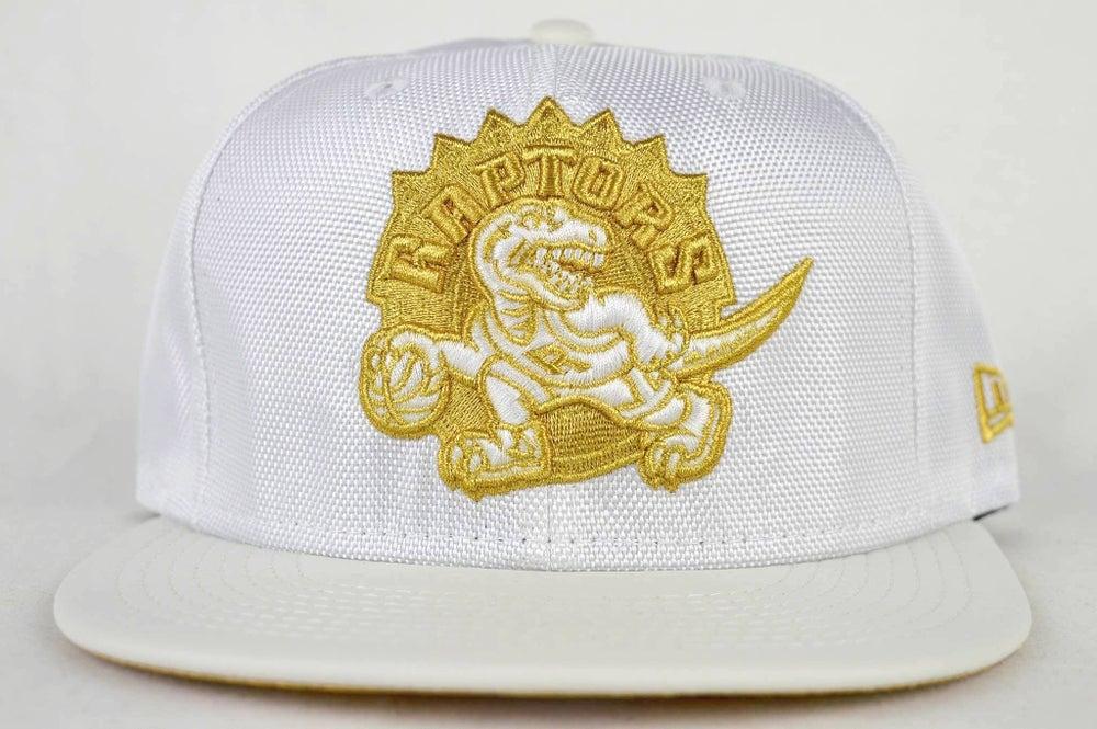 Image of TORONTO RAPTORS BALLISTIC PATENT NBA NEW ERA 950 SNAPBACK CAP