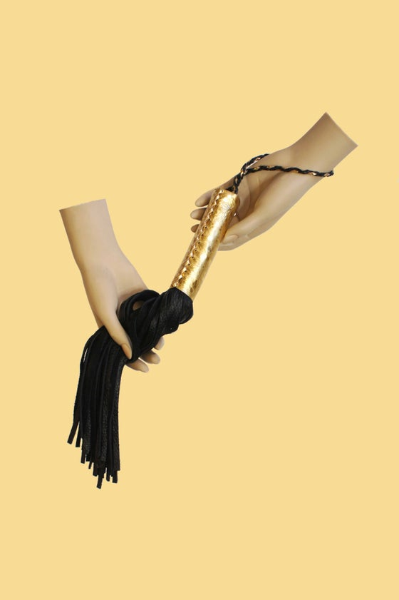 Image of Royal leather flogger in gold and black