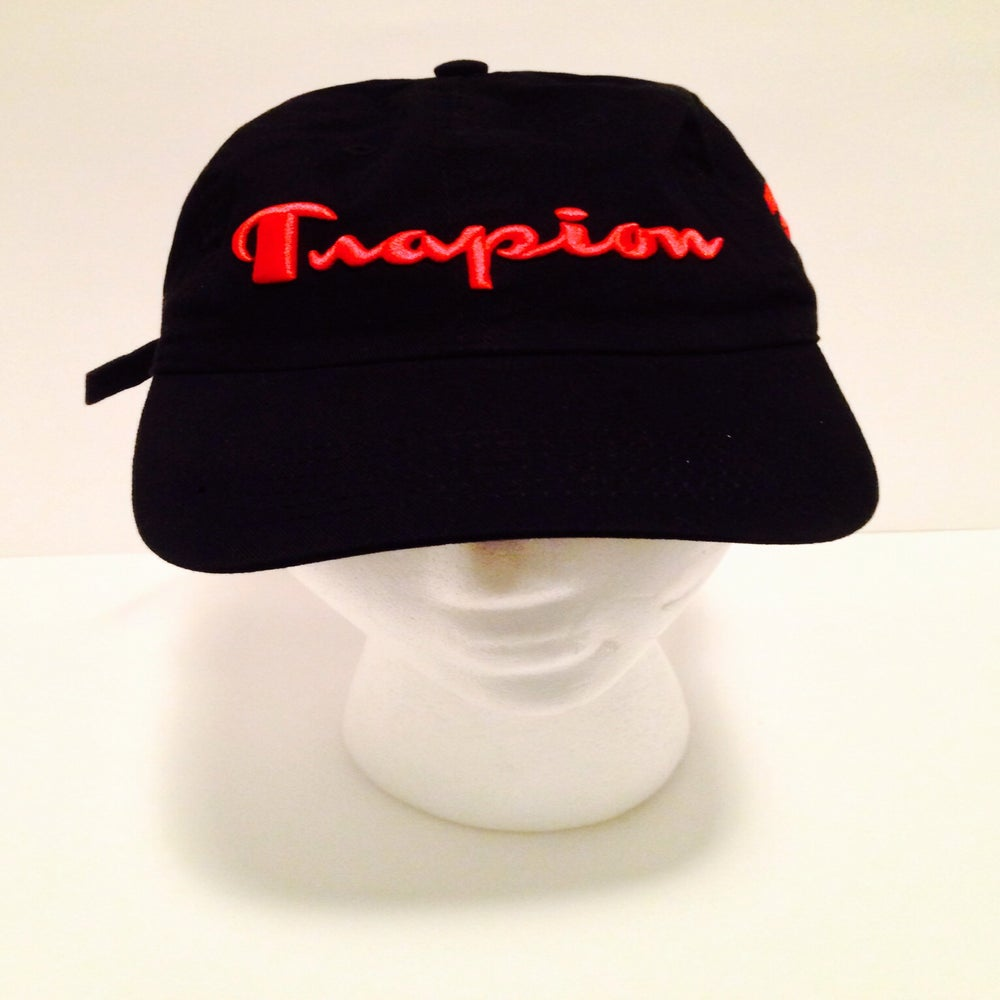 Image of Trapion strap back black red