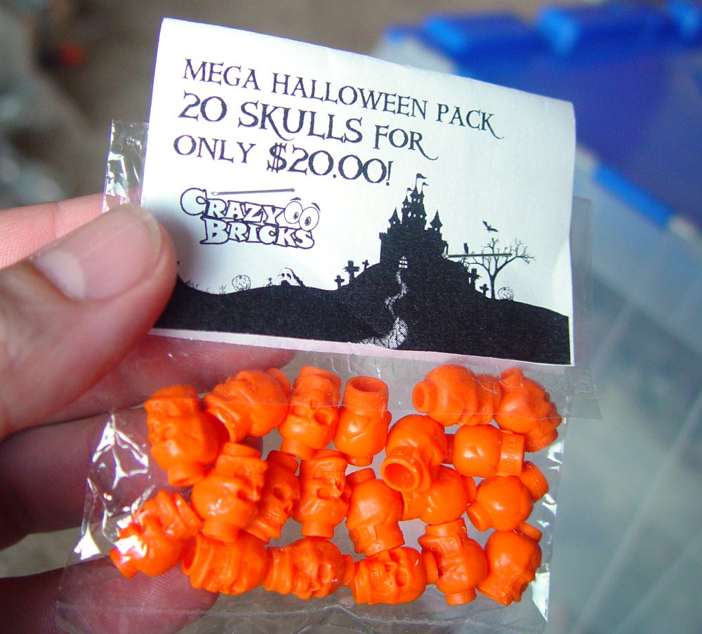 Image of 20 pack of Orange skulls for just $10 = MEGASALE!