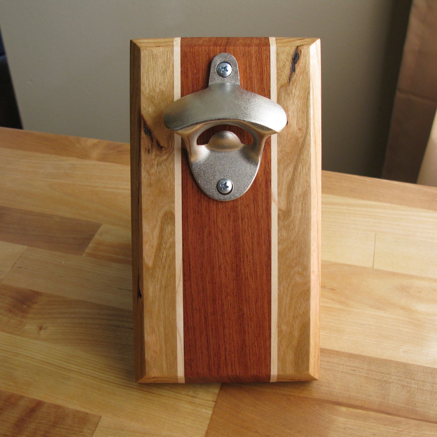 Image of Cherry, maple, and bubinga magnetic bottle opener