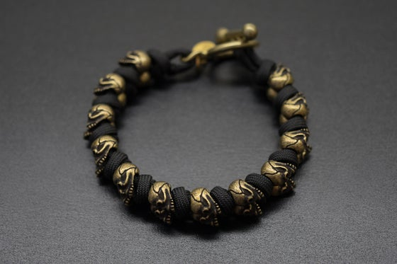 Image of Evil Twins Brass Skull Bracelet