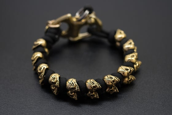 Image of Evil Twins 18K Gold Skull Bracelet
