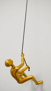 Image of CLIMBING MAN - GOLD