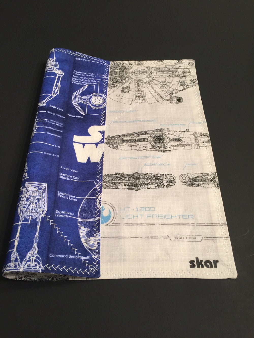 Image of Rey's Speeder and Millinnium Falcon with blue prints
