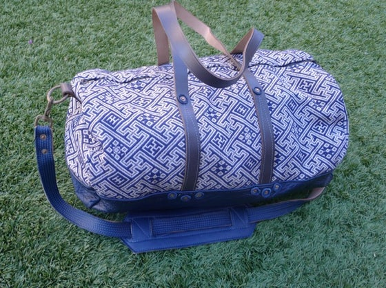 "Image of THE DIVINE TRAVELER ""GETAWAY"" DUFFLE BAG"
