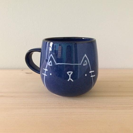 Image of blue glaze mugs -- ready to ship!