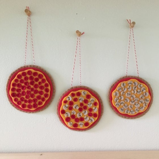 Image of whole pizza wall hangings
