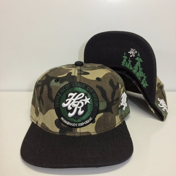 """Image of """"Referrals"""" Camo Snapback - Flat or Curved Bill"""