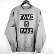 Image of 'FAME IS FAKE'