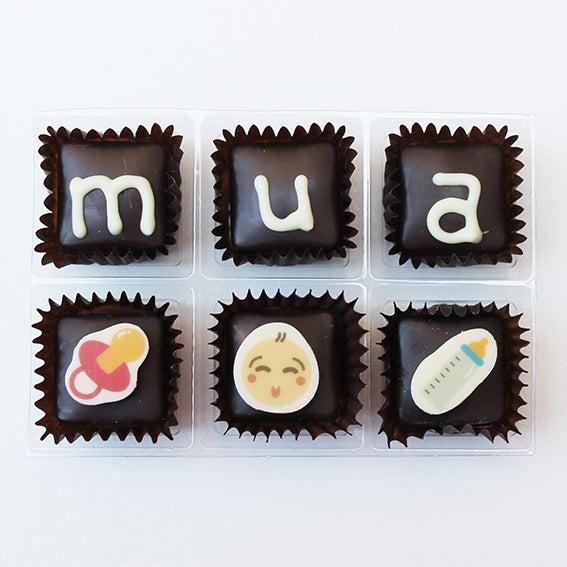"""Image of Xocowhats, missatge de xocolata: """"mua"""" naixement"""