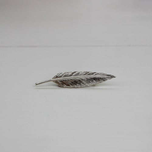 Image of quill lapel pin