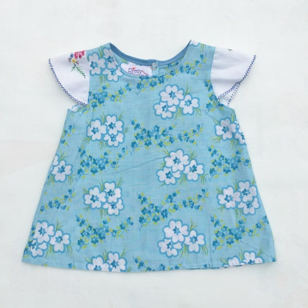 Image of Baby doily sleeved dress - size 00 - Blue floral