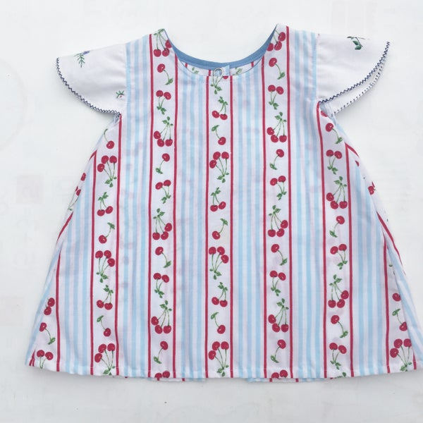 Image of Baby doily sleeved dress - size 00 - cherry stripes