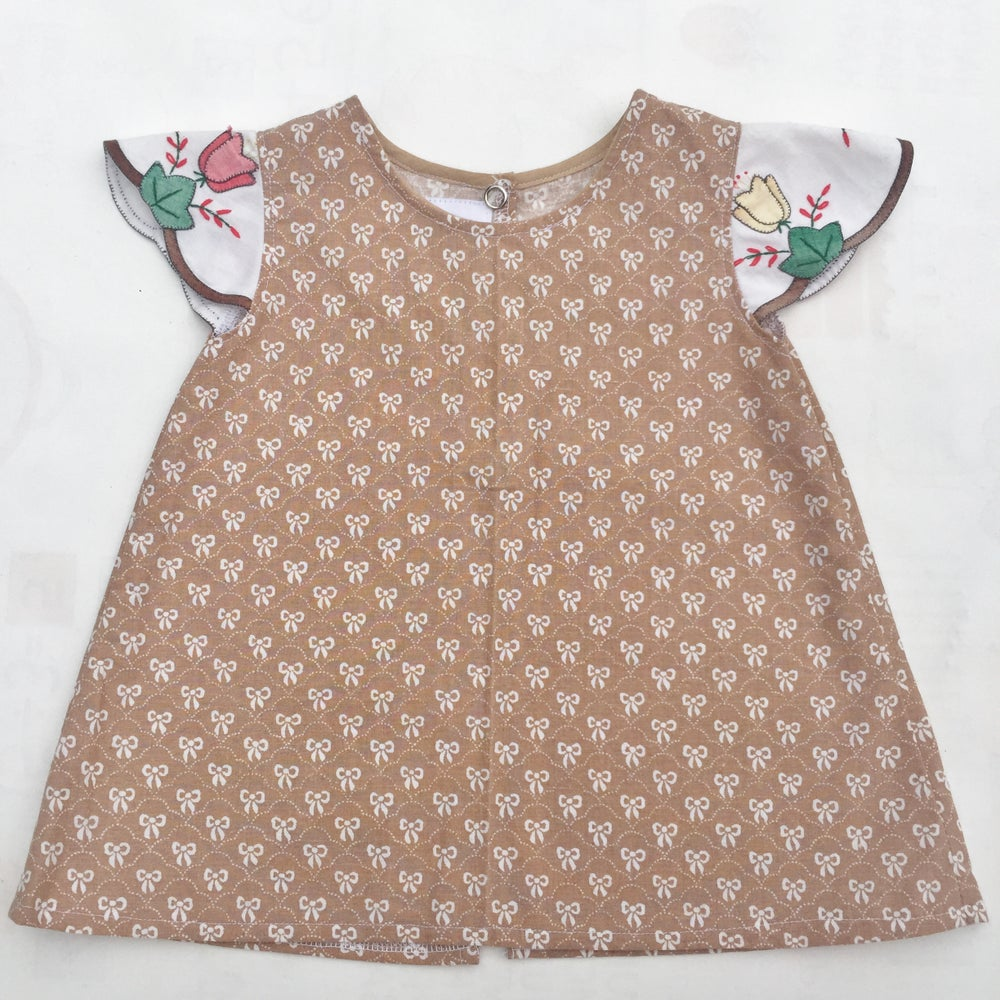 Image of Baby doily sleeved dress - size 00 - brown bows