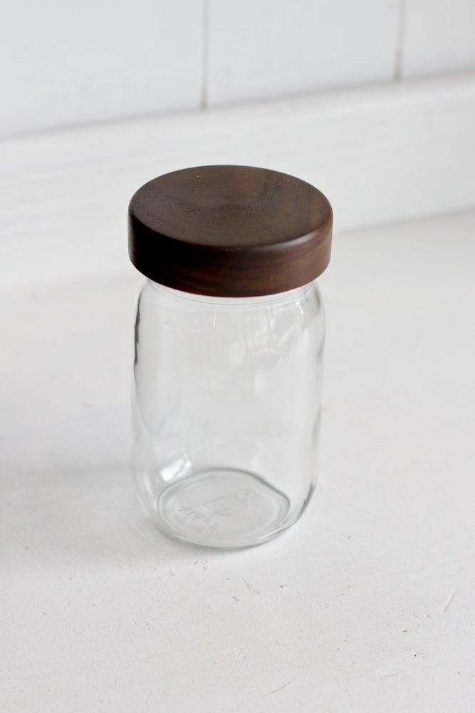 Image of Mason jar with walnut lid 16 oz.