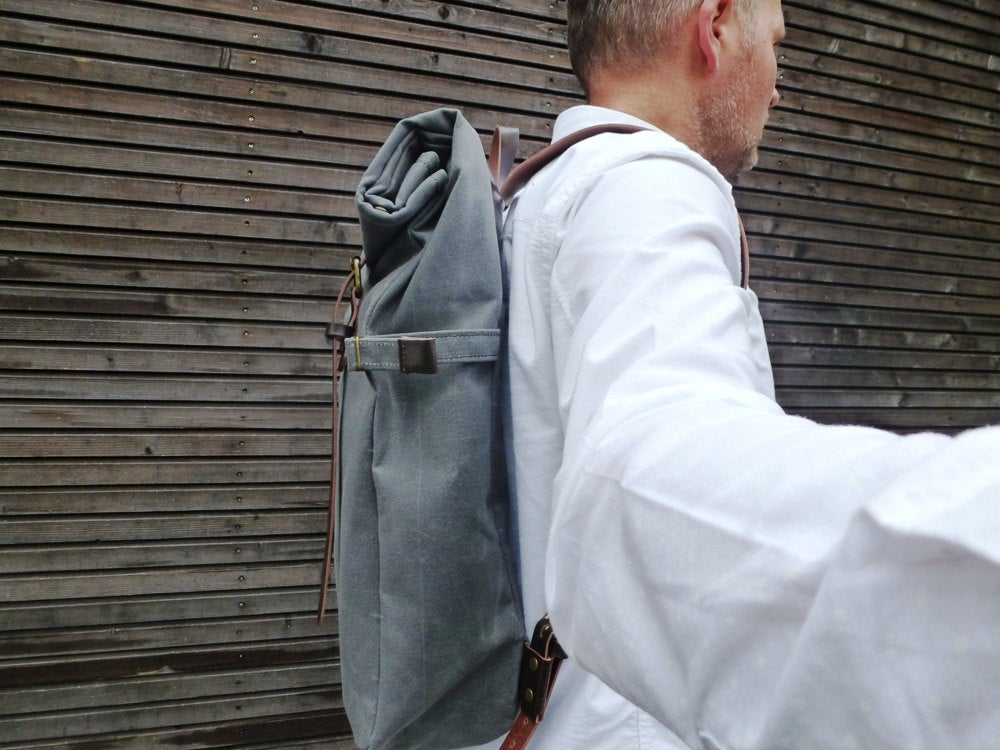 Image of Waxed canvas backpack with roll to close top and leather shoulder straps