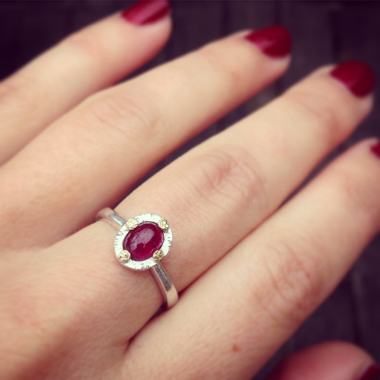 Image of ruby cab ring in 18k gold and sterling silver