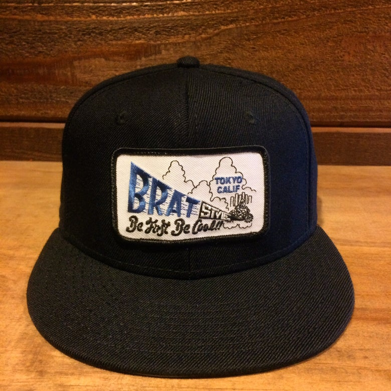Image of BRAT STYLE wool snap back designed by Fusty works