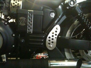 Image of Triumph Speedmaster America pillion peg relocator / frame finisher