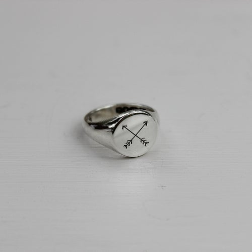 Image of men's signet ring with arrows