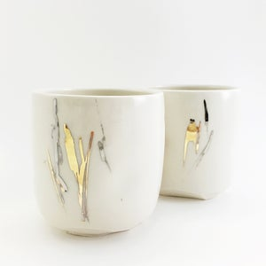 Image of silver and gold altered tumbler
