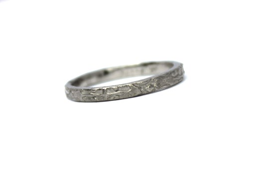 Image of thin 14k white gold wedding band . tudor rose . R2