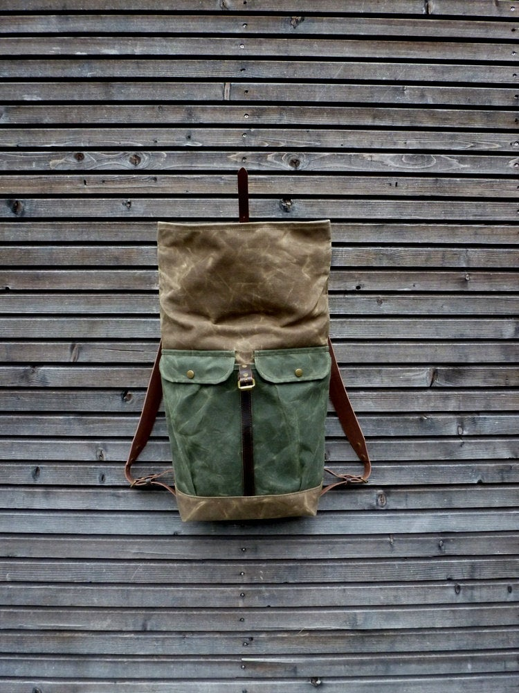 Image of Waxed canvas backpack with roll to close top and vegetable tanned leather shoulder straps