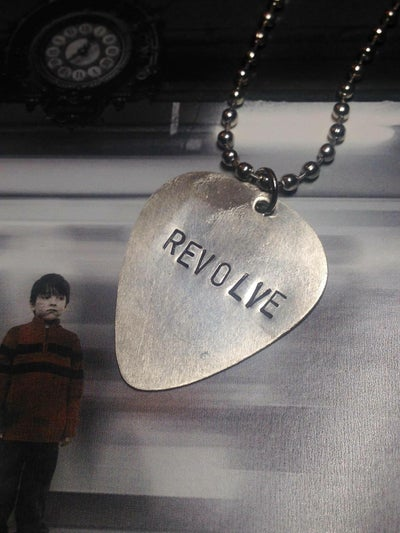 Image of REVOLVE Guitar Pick Necklace