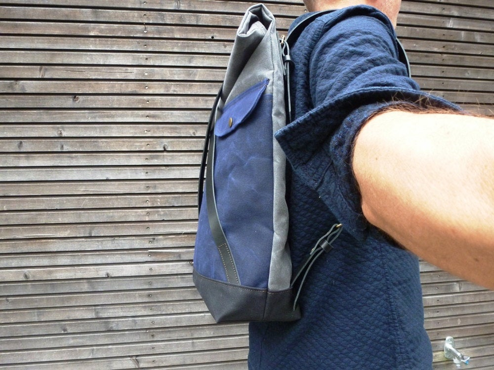 Image of Waxed canvas backpack with roll to close top and leather X strap closing