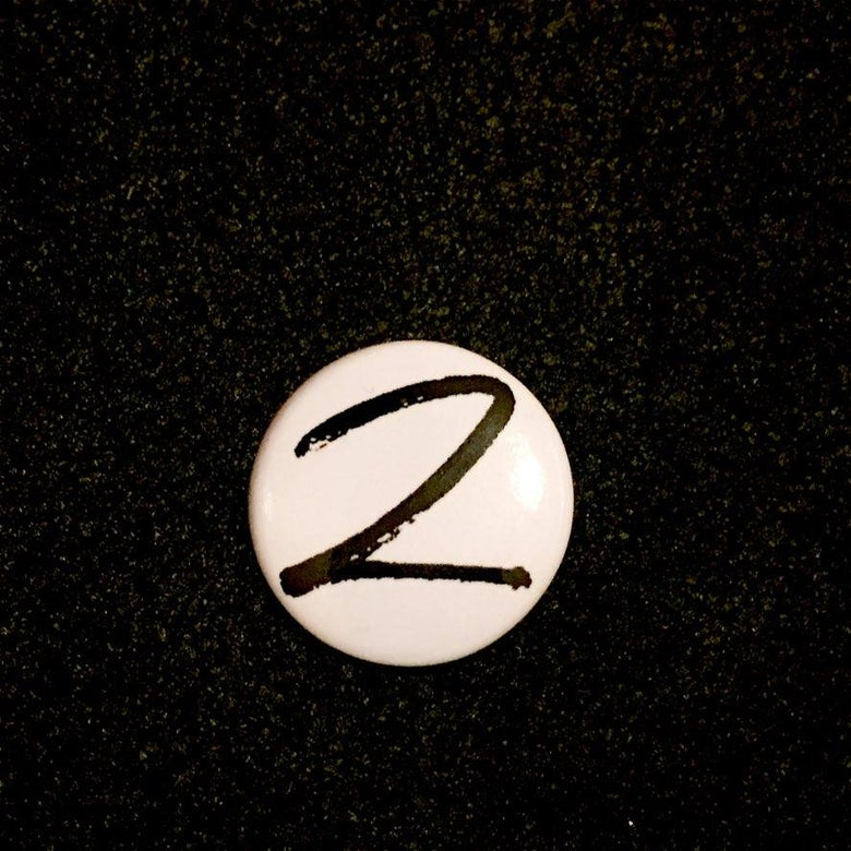 Image of Badge (white)